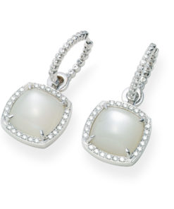 18k white gold earrings with a white cabuchon cut moonstone surrounded by a halo of small brilliants.
