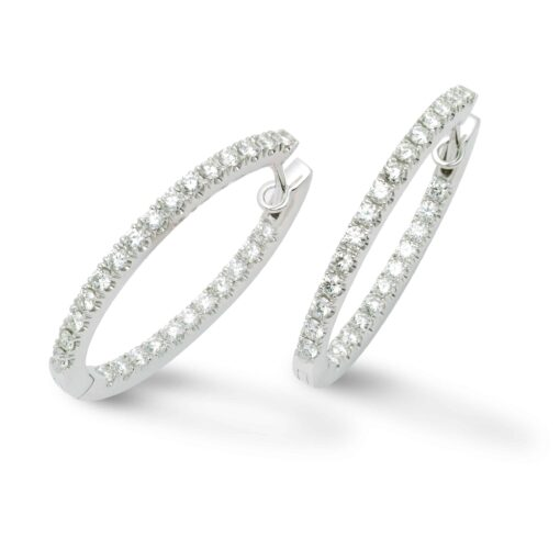 This 18k white golden hoop earrings are set with brilliant cut diamonds.