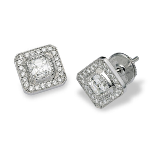 18k white gold cushion-cut diamond earrings surrounded by bead-set diamonds evokes the glamour of the Edwardian period.