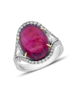 Stunning white gold ring adorned with an important buff top tourmaline, brilliants and two triangle diamonds.